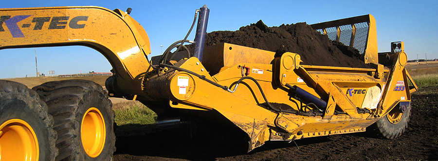 K-Tec 1233ADT Scraper Model in West Canada Topsoil