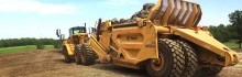 K-Tec 1254ADT Scraper Model with Caterpillar ADT Loading Rocks